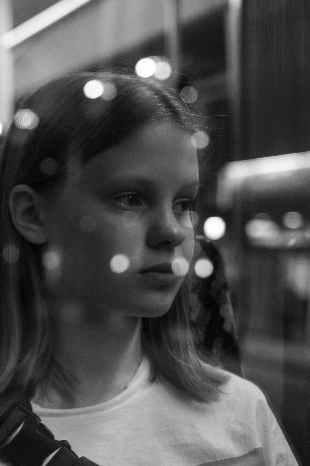Martina Büttner: Reflection portrait in tramway, Berlin